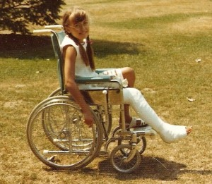 Carol in wheelchair at age nine